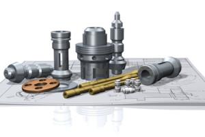 Bild mit Drehteilen und Zeichnung für den Aufbau einer CNC Fräse